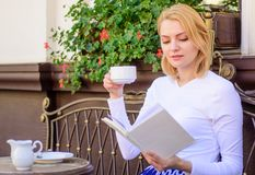 Girl drink coffee every morning at same place daily ritual. Woman have drink cafe terrace outdoors. Bookworm leisure. Concept. Mug of good coffee and pleasant stock images