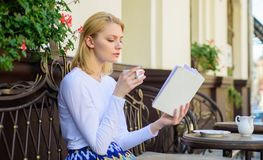 Girl drink coffee while read new bestseller book by popular author. Perfect morning concept. Mug coffee and interesting. Book best combination perfect weekend stock photos