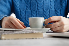 Girl drink espresso coffee from small cup Stock Images
