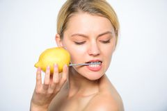 Girl drink fresh juice whole lemon fruit. Recharge your body vitamins. Energy source and vitality. Battery concept. Nutritious drink fill with energy. Lemon royalty free stock photos
