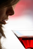Girl drink a glass of alcoholic beverage Royalty Free Stock Images