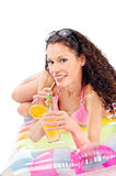 Girl drink juice on air mattress. Smiled curl girl drink juice on air mattress, isolated on white Royalty Free Stock Photo