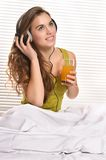 Girl drink juice in bed Royalty Free Stock Photo
