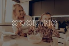 Little Girl Drink Juice. Happy Family Cooking. Girl Drink Juice. Happy Family Cooking. Grandmother Smile. Girl Whiping Egg in Glass Bowl. Grandmother Help Girl stock image