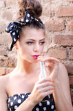 Girl drink a juice. Young pin up girl drink a juice Stock Photography