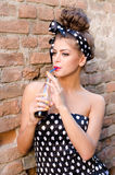 Girl drink a juice. Young pin up girl drink a juice Royalty Free Stock Images