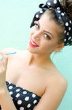 Girl drink a juice. Young pin up girl drink a juice Stock Images