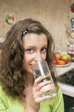 Girl drink poor water Royalty Free Stock Image