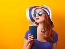 Girl with drink and sunglasses Stock Photos