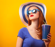 Girl with drink and sunglasses Royalty Free Stock Images