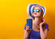 Girl with drink and sunglasses Royalty Free Stock Image