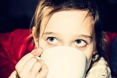 Girl drink tea Stock Photos