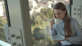 Girl drink tea by the window of trendy restaurant stock video