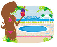 Girl with a drink on tropical pool Stock Image