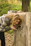 Girl drink water. Woman drink at the water fountain in a park Royalty Free Stock Photo
