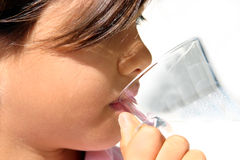 Girl drinking. Thirsty nine year old girl drinking from a glass. Fit for health, growing, nutrition, happy child, etc, layout Stock Images