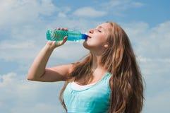 Girl drinking Stock Image