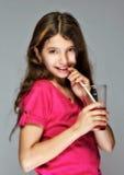A girl drinking Royalty Free Stock Photos