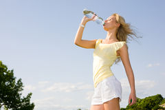 Girl drinking Stock Photography