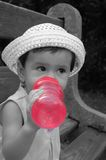 Girl drinking. Little girl in the park drinking water Stock Photos