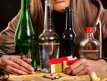 Girl  drinking alcohol and smokes cigarettes Royalty Free Stock Photo