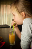 Girl drinking apple juice stock photo
