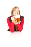 Girl drinking beer from the mug Stock Image