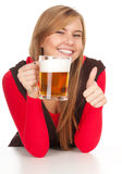 Girl drinking beer from the mug Royalty Free Stock Image
