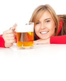 Girl drinking beer from the mug Stock Images