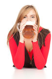Girl drinking beer from the mug Royalty Free Stock Photos