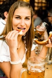 Girl drinking beer at Oktoberfest Royalty Free Stock Images