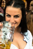 Girl drinking beer at Oktoberfest Royalty Free Stock Photos