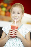 Girl Drinking A Berry Smoothie Royalty Free Stock Photo
