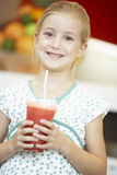 Girl Drinking A Berry Smoothie Royalty Free Stock Photos