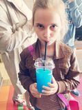 Girl drinking blue cold drink Royalty Free Stock Photography