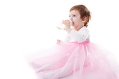 Girl is drinking from bottle Royalty Free Stock Photo