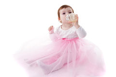 Girl is drinking from bottle Royalty Free Stock Images