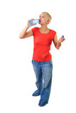Girl drinking a bottle of water Stock Images