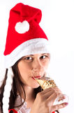 Girl drinking champagne in Christmas custome Stock Images