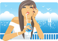 Girl drinking cocktail. Girl drinking cooling cocktail on the beach Stock Photography