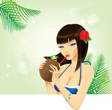 Girl drinking coconut cocktail Stock Photo