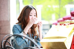 Girl drinking coffee Stock Image