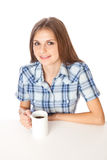 A girl is drinking a coffee Stock Photos