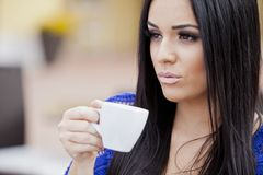 Girl drinking coffee Royalty Free Stock Photos