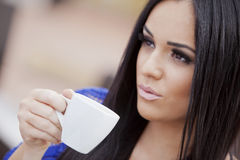 Girl drinking coffee Royalty Free Stock Images