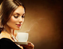 Girl Drinking Coffee. Coffee. Beautiful Girl Drinking Tea or Coffee royalty free stock photography