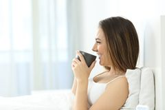 Girl drinking coffee at breakfast in the morning on the bed stock photos