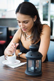 Girl drinking coffee in cafe Royalty Free Stock Photo