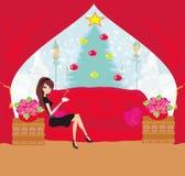 Girl drinking coffee on Christmas morning Royalty Free Stock Photos