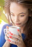 Girl drinking coffee in close up photo Royalty Free Stock Image